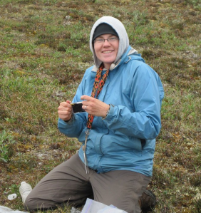 PhD student Crystal Ernst, happily working on the Arctic tundra.