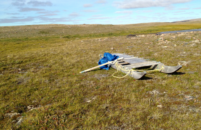 Sled on the tundra: waiting for winter.