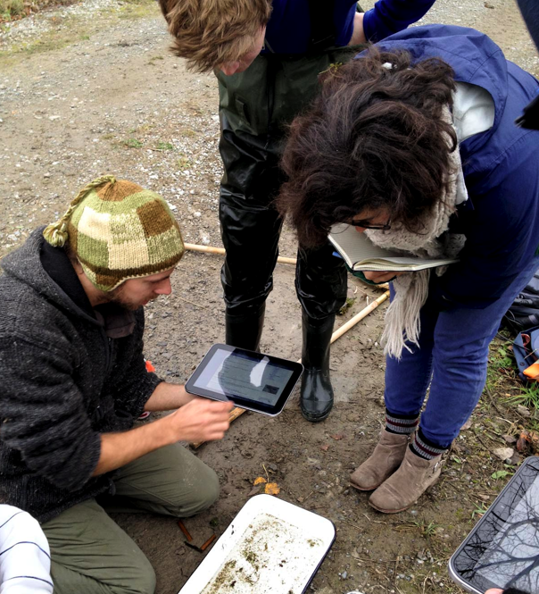 A group using a Toshiba tablet to help identify an aquatic invertebrate